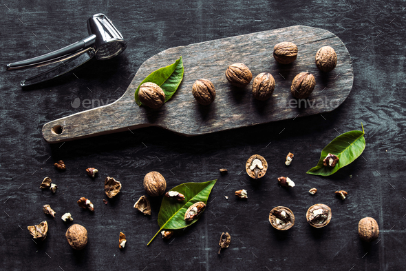 Walnuts on dark vintage table. healthy food. Old vintage table and leaves from the nut - Stock Photo - Images