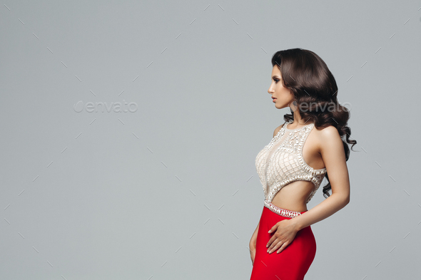 Gorgeous brunette posing in shiny dress with diamonds - Stock Photo - Images