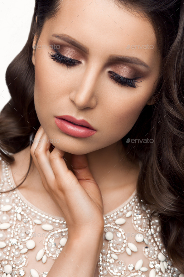 Brunette in shine dress with perfect makeup, touching face - Stock Photo - Images