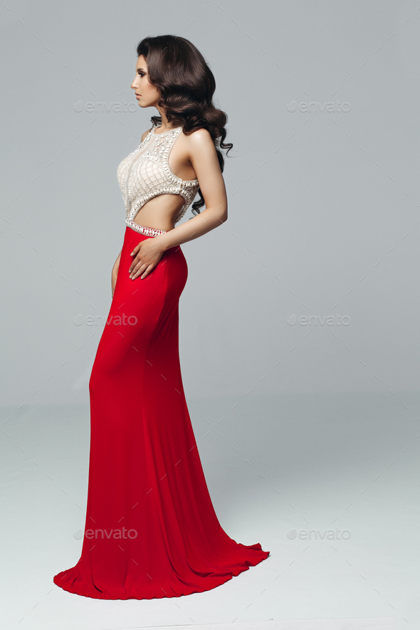 Gorgeous brunette in elegant long dress with cristal - Stock Photo - Images