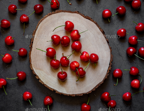 cherries on trunk - Stock Photo - Images