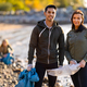 Young serious multi-ethnic environmental volunteers standing at beach - PhotoDune Item for Sale