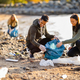 Team of dedicated and smiling volunteers collecting garbage at beach - PhotoDune Item for Sale