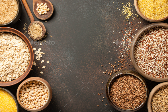 Set with various cereal grains on metallic surface - Stock Photo - Images