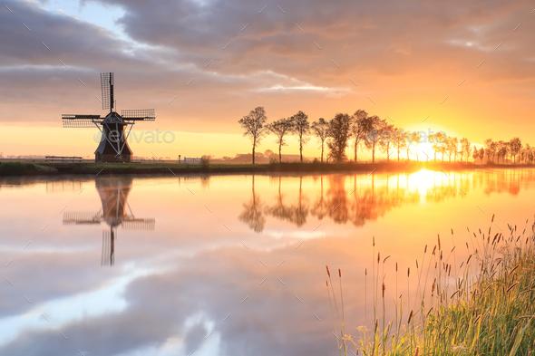 Dutch windmill during beautiful sunrise - Stock Photo - Images