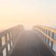 wooden bridge in dense fog at sunrise - PhotoDune Item for Sale