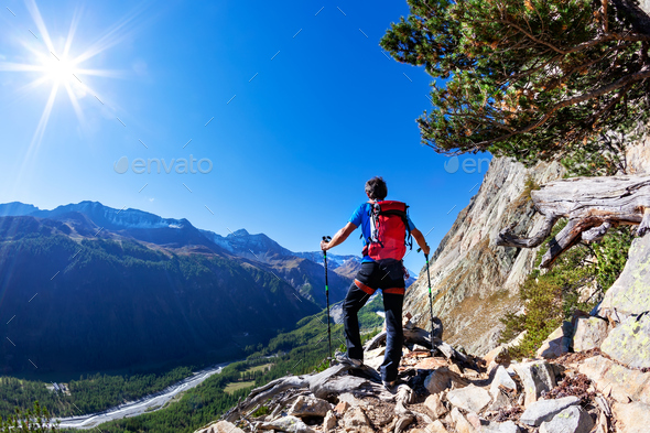 Hiker takes a rest observing a mountain panorama. Mont Blanc - Stock Photo - Images