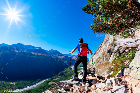 Hiker takes a rest observing a mountain panorama. Mont Blanc Massif, Italian Alps, - Stock Photo - Images