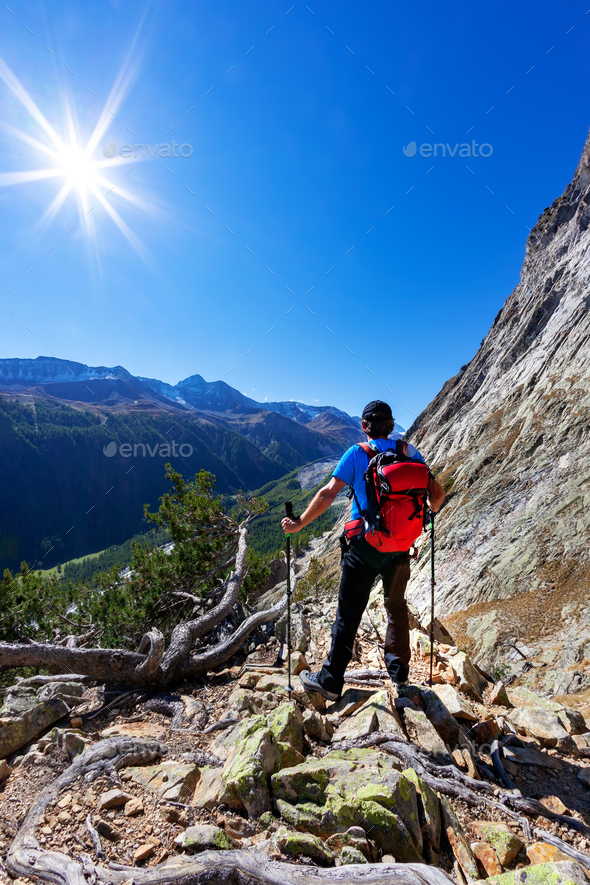Hiker takes aama. Mont Blanc Massif rest - Stock Photo - Images