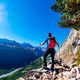 Hiker takes a rest observing a mountain panorama. Mont Blanc Massif, Italian Alps, - PhotoDune Item for Sale