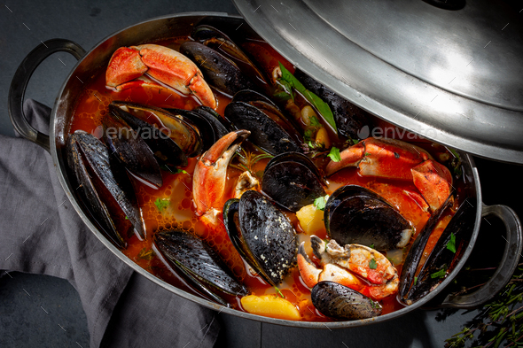 Seafood soup with mussels and crabs in metal pot - Stock Photo - Images