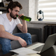 Man drinking beer and searching for job in internet - PhotoDune Item for Sale