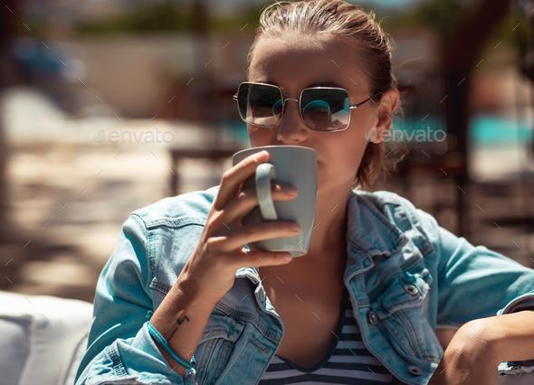 Enjoying Coffee Outdoors - Stock Photo - Images