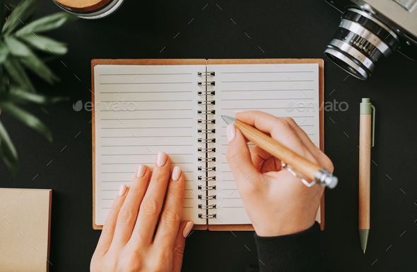 Flat lay woman's hand writes down addresses - Stock Photo - Images