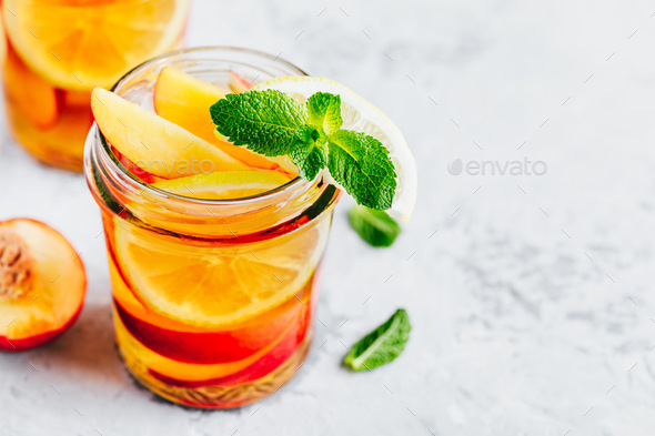 Cold peach and lemon iced tea. Summer refreshing drink - Stock Photo - Images