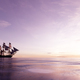 Pirate ship sailing on the ocean at sunset - PhotoDune Item for Sale