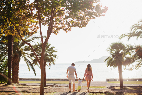 unidentified family vacation on luxury beach - Stock Photo - Images