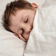 Sleeping young boy in white bed - PhotoDune Item for Sale