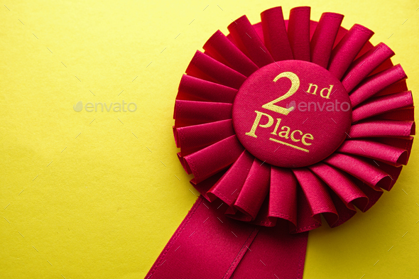 Red ribbon rosette for the second place runner up - Stock Photo - Images