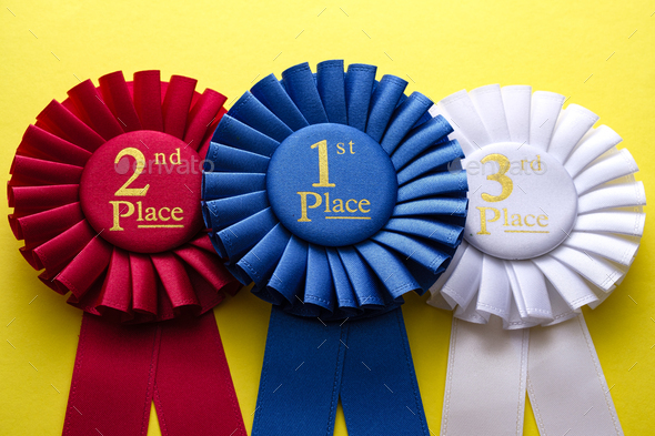 Three rosettes for the winner and runners up - Stock Photo - Images
