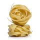 Coils of dried Italian pasta or noodles on white - PhotoDune Item for Sale