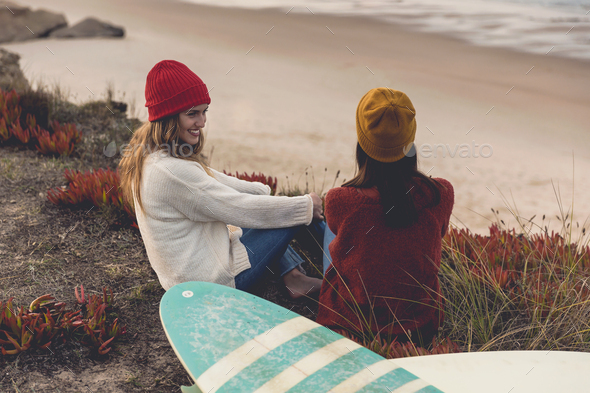 Surfer girls at the beach - Stock Photo - Images