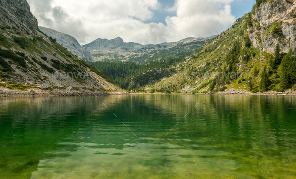 Krn lake reflections on a summer day - Stock Photo - Images