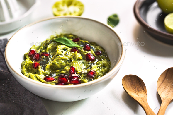 Avocado dip with Basil Olive oil and Pomegranate topping - Stock Photo - Images