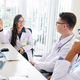 Pulmonologist talking to colleagues - PhotoDune Item for Sale