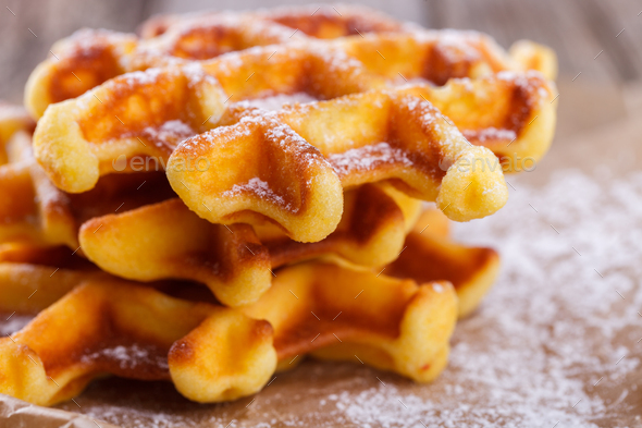 Belgian waffles with blueberries sprinkled with powdered sugar - Stock Photo - Images