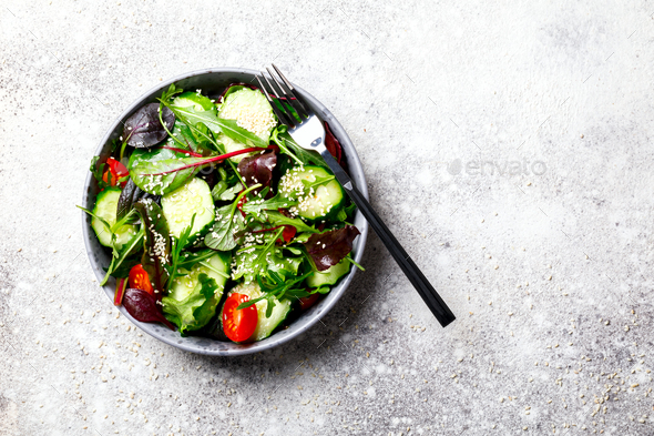 Vegetable salad in a glass bowl with greens.Vegetarian Concept - Stock Photo - Images
