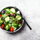 Vegetable salad in a glass bowl with greens.Vegetarian Concept - PhotoDune Item for Sale