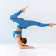 Athletic woman doing an elbow stand yoga pose - PhotoDune Item for Sale