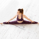 Athletic woman doing a frontal split yoga pose - PhotoDune Item for Sale