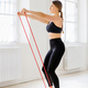 Woman athlete training with a power band - PhotoDune Item for Sale
