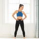 Fit muscular woman standing in a high key room - PhotoDune Item for Sale