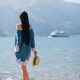 romantic woman stay on beach and look on cruise ship - PhotoDune Item for Sale