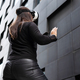 Back Of Woman Wearing Virtual Reality Technology Glasses Against Modern Building - PhotoDune Item for Sale