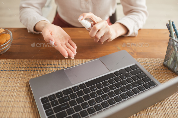 Businesswoman Using hand Sanitizer Close Up - Stock Photo - Images
