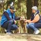 Active Senior Couple Petting Big Dog - PhotoDune Item for Sale