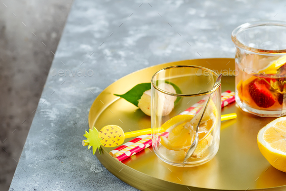 Set from homemade refreshing cold lemonade from berries and lemon fruits in a glasses with plastic - Stock Photo - Images