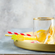 Glass for preparing homemade lemonade from lemon and fresh berries on a golden tray on a gray stone - PhotoDune Item for Sale