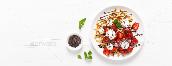 Belgian waffles with fresh strawberry, chocolate topping and whipped cream. Banner - Stock Photo - Images