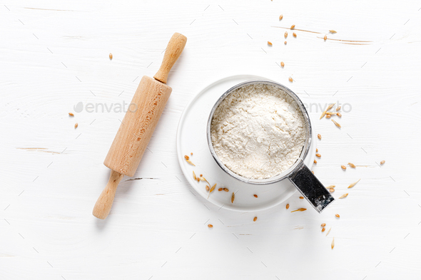 Flour on white kitchen worktop, baking culinary background, copy space, overhead view - Stock Photo - Images
