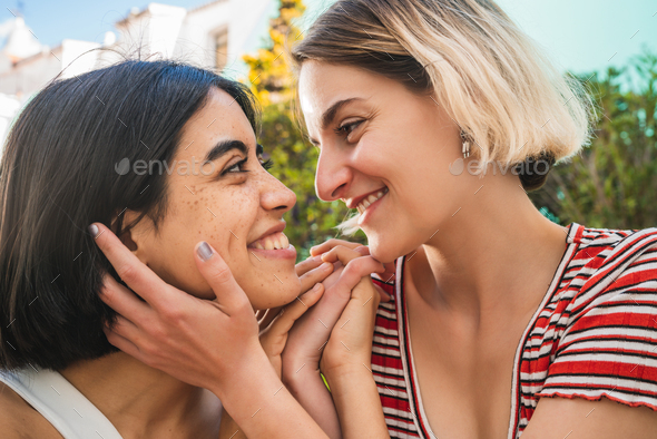 Loving lesbian couple having a date. - Stock Photo - Images