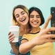 Lovely lesbian couple taking a selfie with phone. - PhotoDune Item for Sale