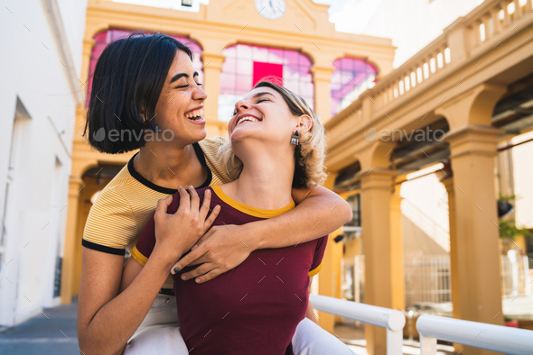 Loving lesbian couple having fun at the street. - Stock Photo - Images