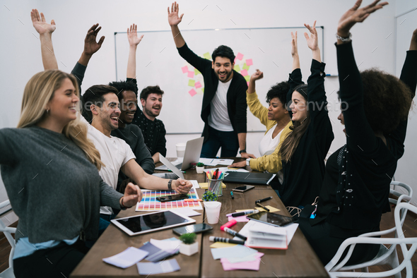 Business team celebrating with raised up hands. - Stock Photo - Images