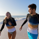 Caucasian couple standing in water at the beach. - PhotoDune Item for Sale