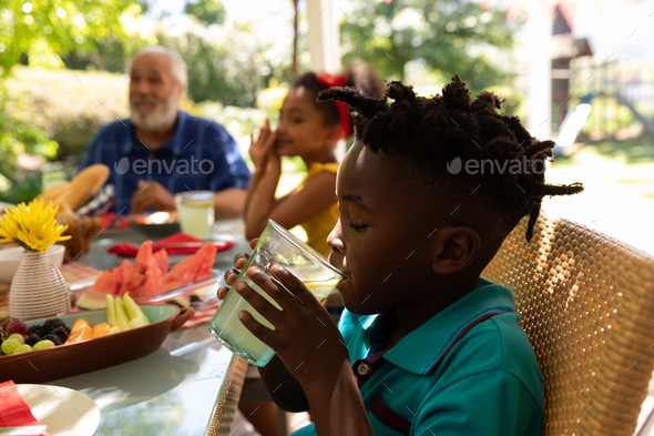 Family eating together at table - Stock Photo - Images